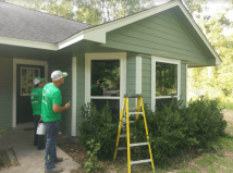 THE-Crew-working-on-siding-job-in-Houston-Texas-compressor